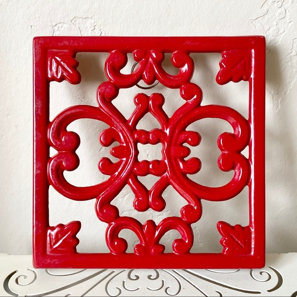 Red iron trivet wall decor